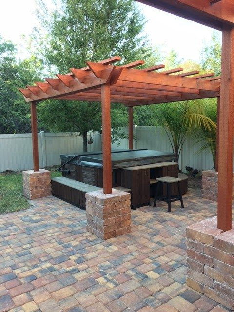 Pergola with spa cover and pavers